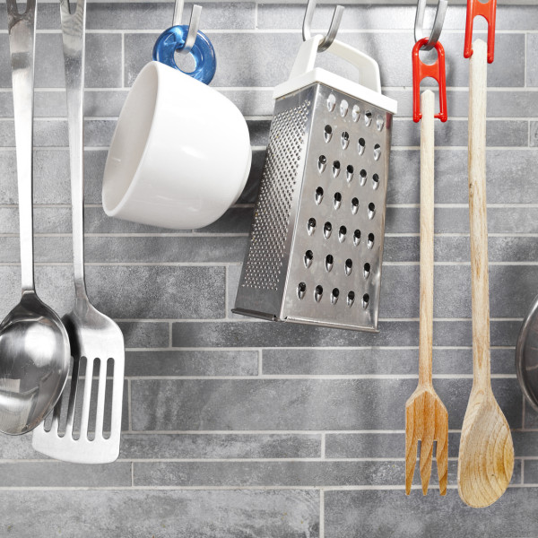 Kitchen tools on a grey tile marble wall