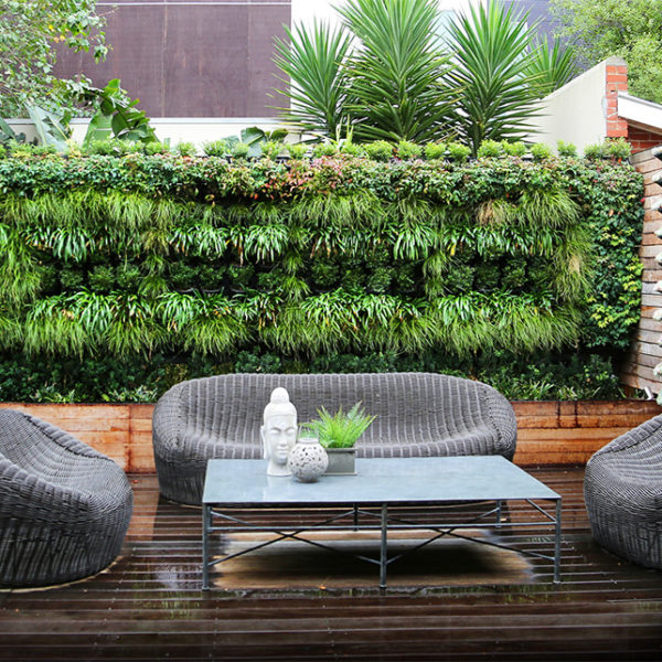 modern-living-room-ideas-with-grey-finish-rattan-chair-and-rectangle-metal-coffee-table-above-dark-brown-hardwood-floor-also-beautiful-vertical-garden-planters-attached-on-wall-decor